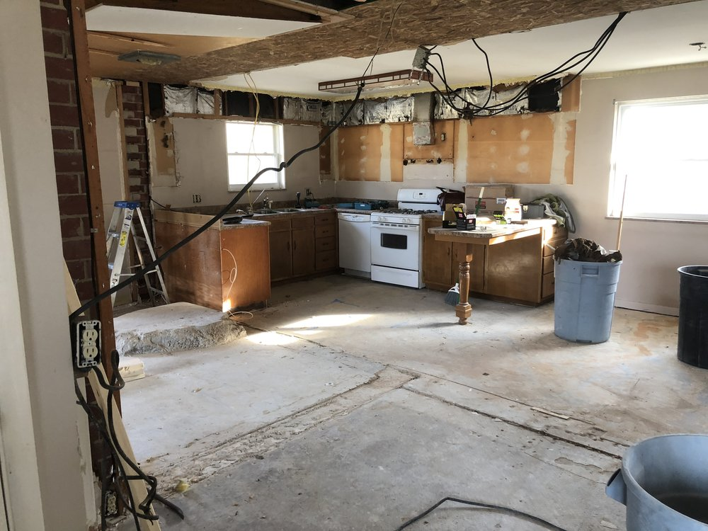 oh yeah, there was a wood burning stove on the left there, we had to chip away at the concrete to remove all of it, and again, no levelness there