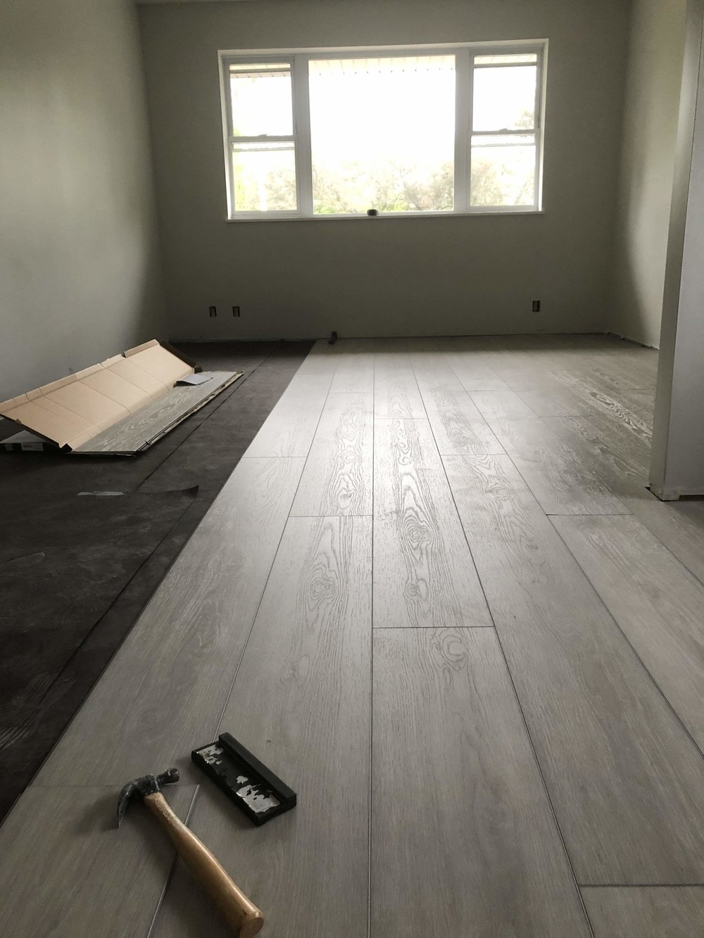 Then I laid the vapour barrier (aka tar paper) and started the flooring