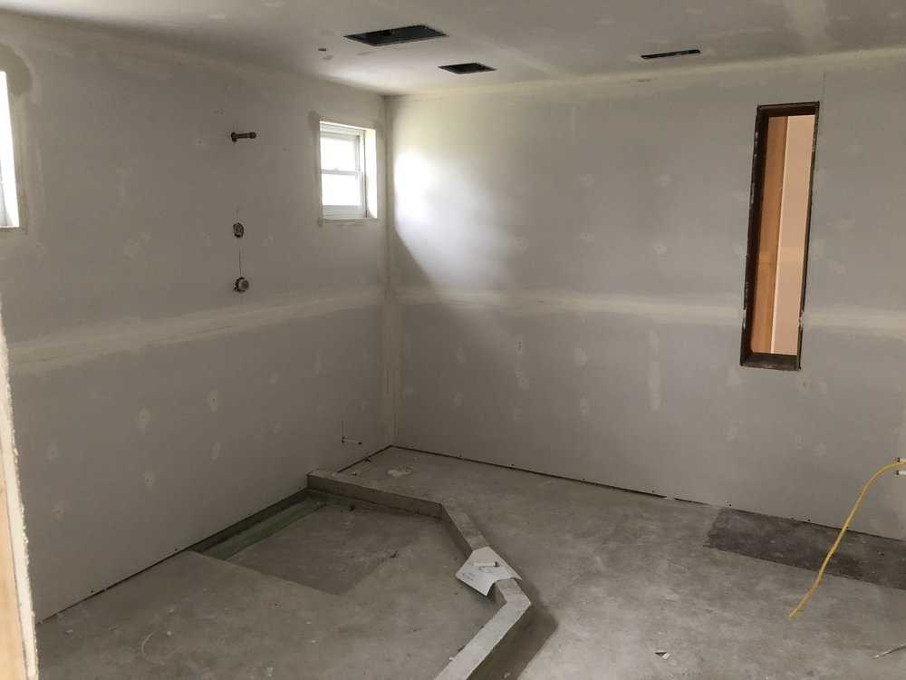 this is the master bathroom before the panels and flooring