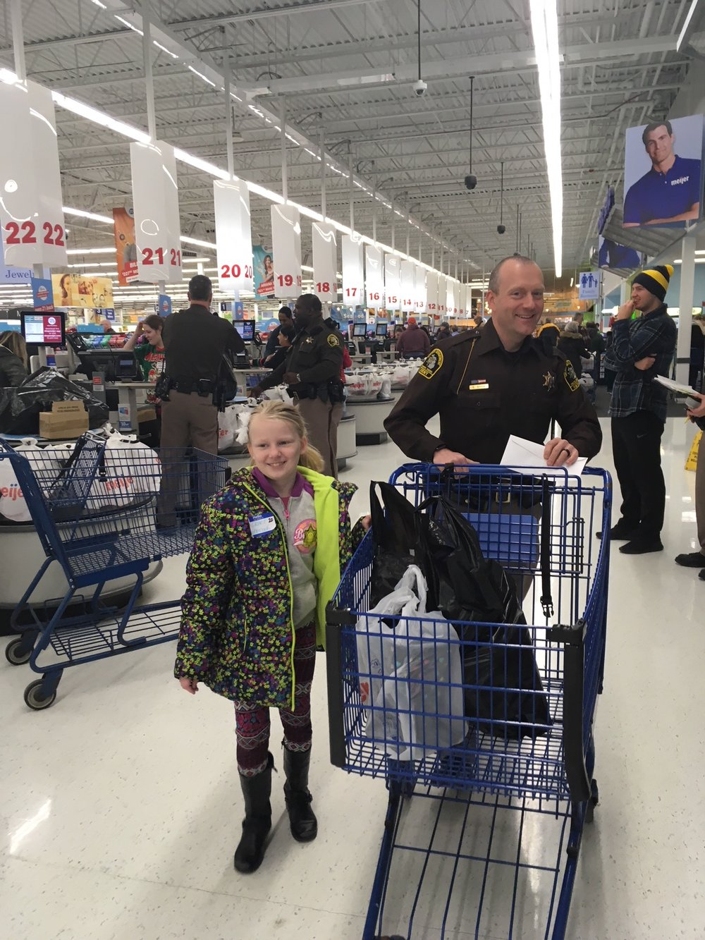 Grace Holbrook with Deputy Scott Shaw are all smiles after shopping.