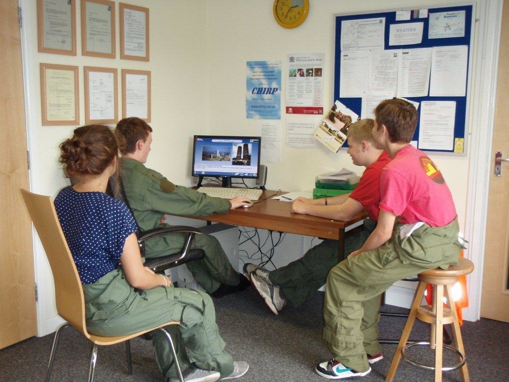 Airport scholarship students using the club computer to learn more about Air Law.
