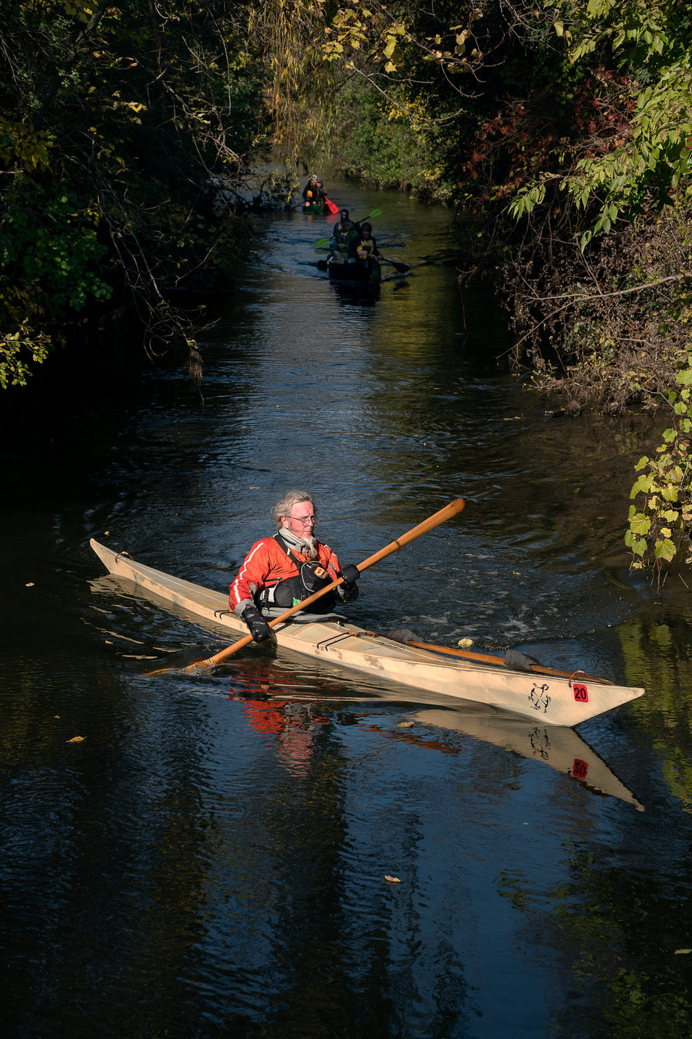 A kayaker approaches the portage at Bassett Creek.