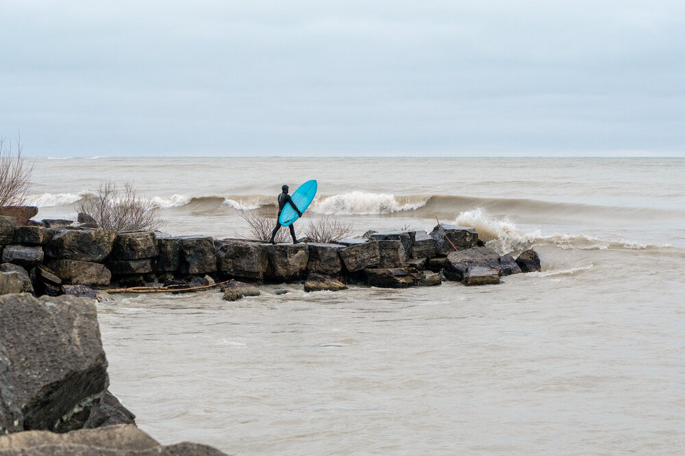 Lake surfer approaches the paddle-out in Racine, Wisconsin.