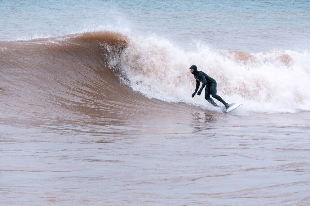 Stefan Ronchetti bottom turns into an overhead Lake Superior right.