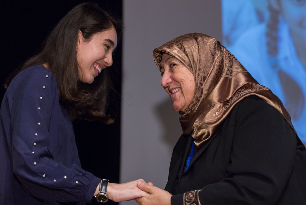 Maryam and Dr. Sakena Yacoobi on stage during CSW62