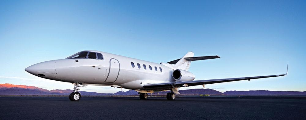 Hawker-800XP_Mid Jet_Exterior-2_Legacy_Aviation_Private_Jet_NetJets_Jet_Charter_TEB_VNY_MIA_PBI_FRG_SFO_FLL_FXE_BED2.jpg
