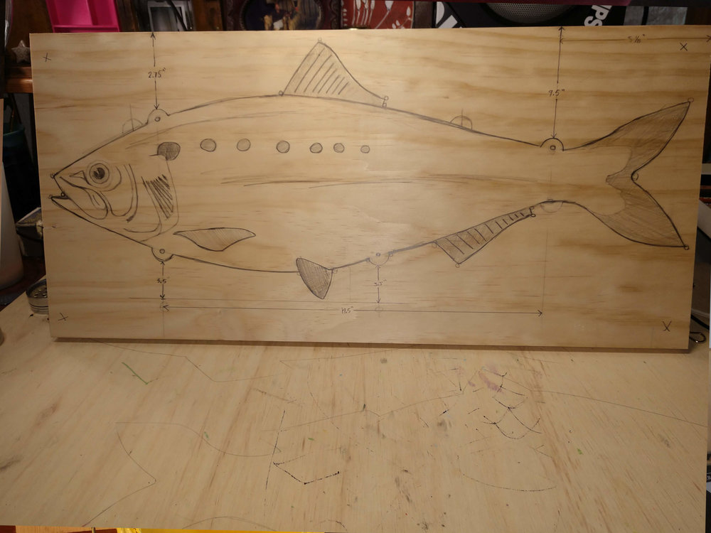 Drawing transferred to wood board ready for cutting.