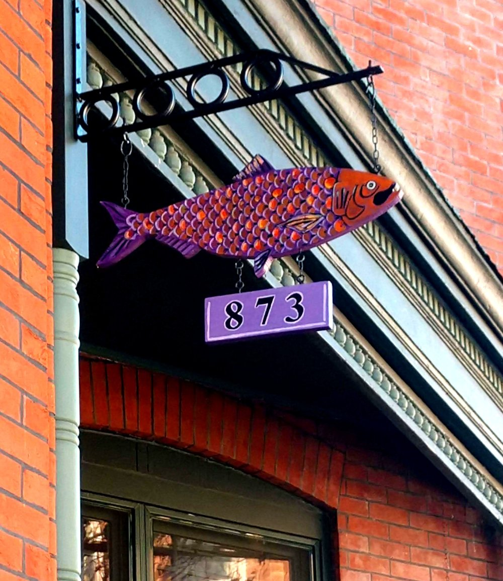 For the Tenenbaum sign we chose colors which would highlight the color scheme of their newly renovated home. This fish was cut and painted by hand by me . -Troy