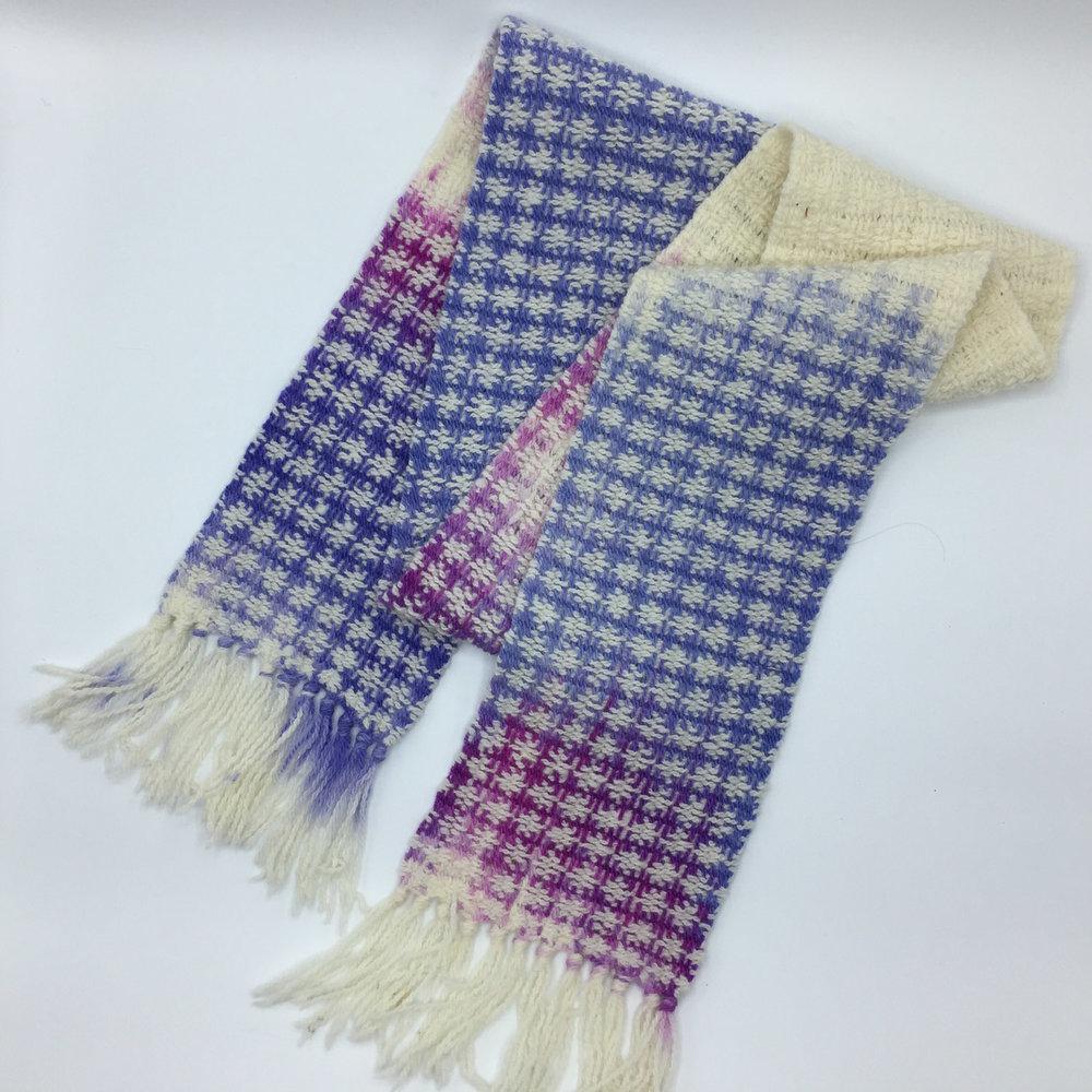 Handwoven painted warp wool scarf.