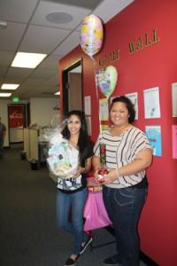Jovana Ortiz (l) and Peepee Matua take home raffle prizes