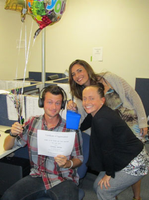 Verifier of the Month Christian McKee (l), receives his award from executive staff