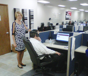 Sara Goldberg attends to a client monitoring call activity