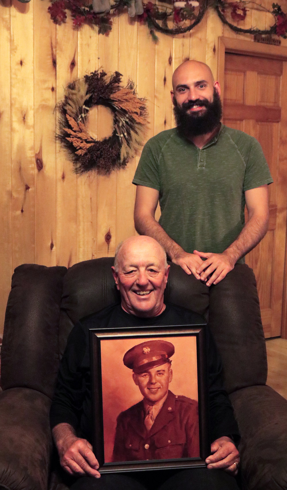 Lucas and Randy with portrait of Ray Kremer.