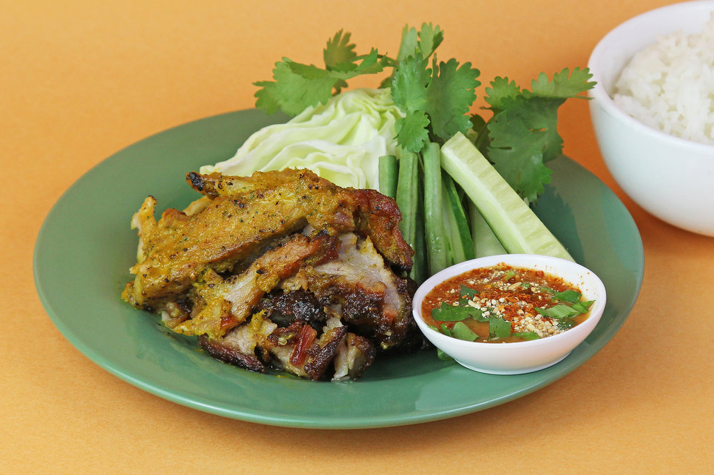 Grilled Pork Shoulder   Marinated with garlic and coriander root served with fresh vegetables and Jeaw Sauce  12