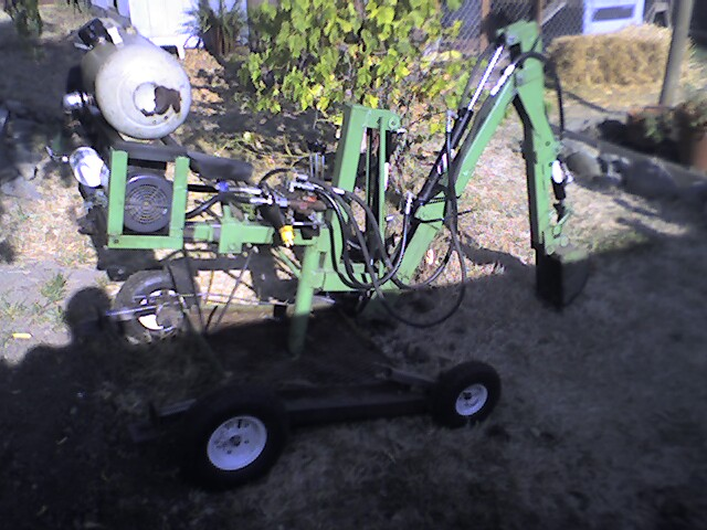 Bill's 110 volt Backhoe - Bill needed to dig the basement out under his house. If the machine will run on batteries then it should run on 110 volt AC.Bill used a 2 HP, 1750 Rpm cw, 115 volt motor to run the HYDRAULIC pump with a 12 gauge, 100 foot EXTENSION cord. this machine will dig out basements as well as digging utilities.Cool machine, bill!