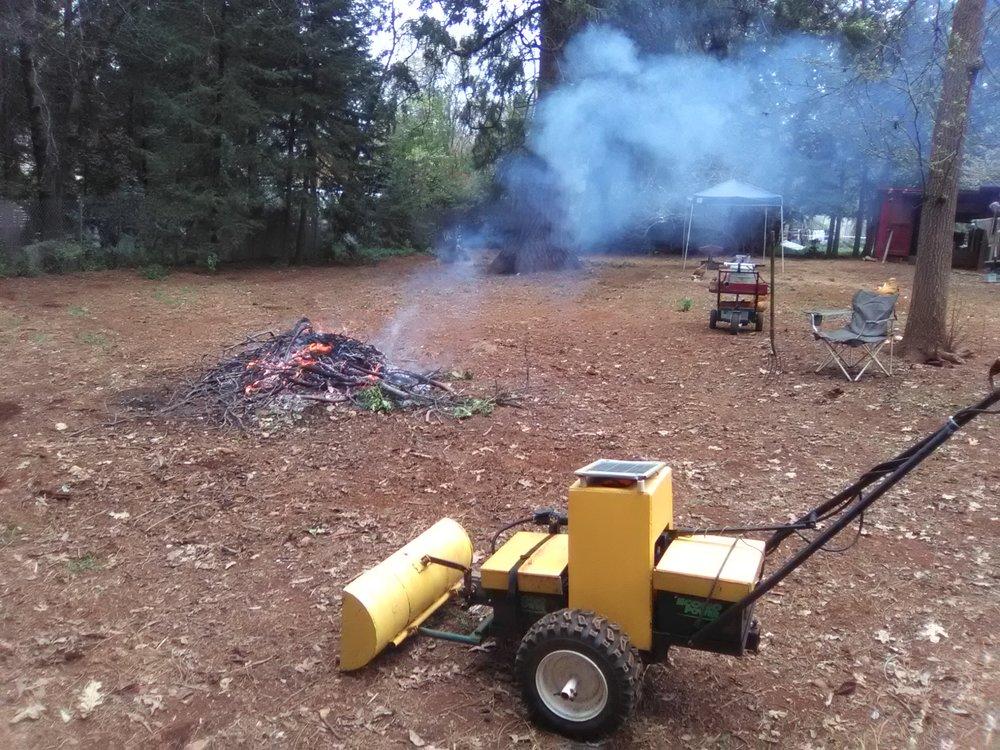 Tractor & burn pile.jpg