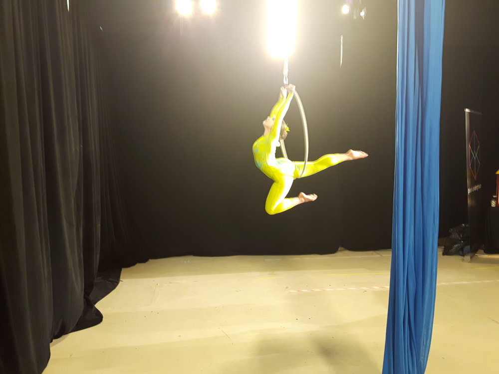 Performer in aerial hope in yellow costume