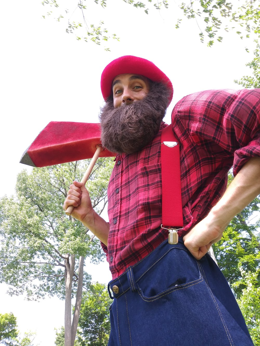 Lumberjack with giant fake axe on stilts