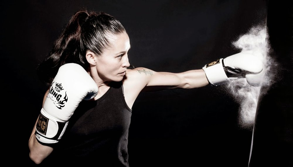 girl kickboxing black and white.jpg