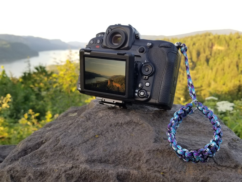 camera wrist strap - These handmade straps are great for any camera and any wrist. The strength of the 550 paracord gives you peace of mind while shooting out in nature, and alleviates any neck strain from traditional neck straps. Attaching at the eyelet, these straps allow you to still utilize a tripod for those longer shutter speeds.