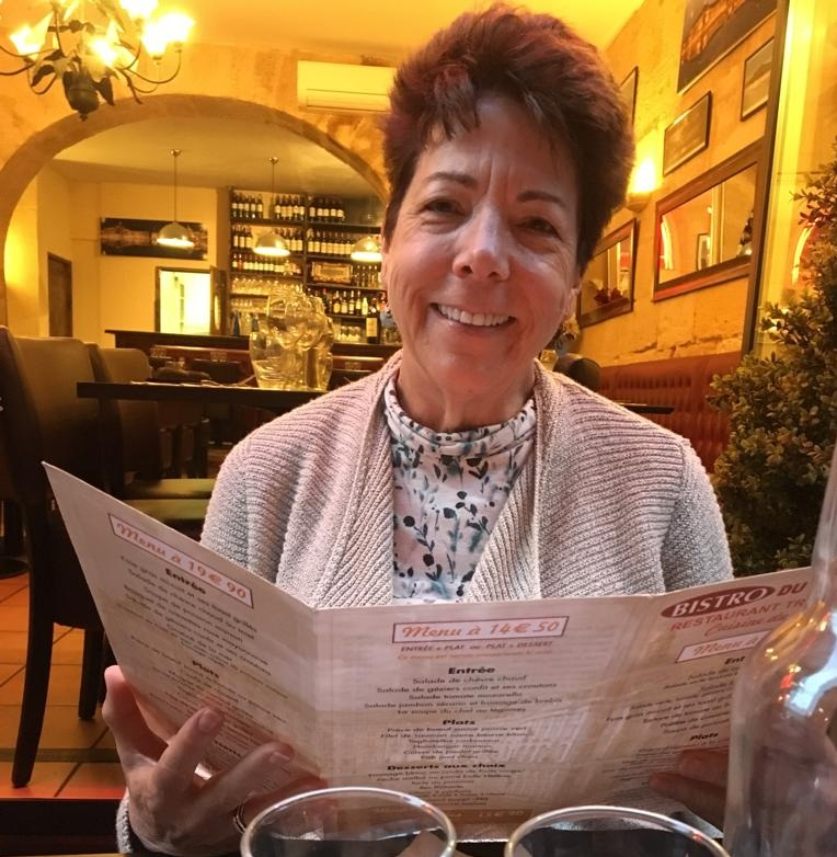 Kathy wining and dining (one of our favorite pastimes)
