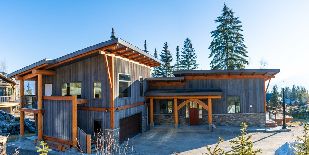Dolinsky's Winter Paradise - The look of the Dolinsky's mountain residence is a vertical wood paneled exterior with select timberframe accents in a traditional natural stain colour. The grey wood siding was treated with eco-friendly natural wood protection. To make their home truly their own, the Dolinsky's personally hand-picked many accent pieces.