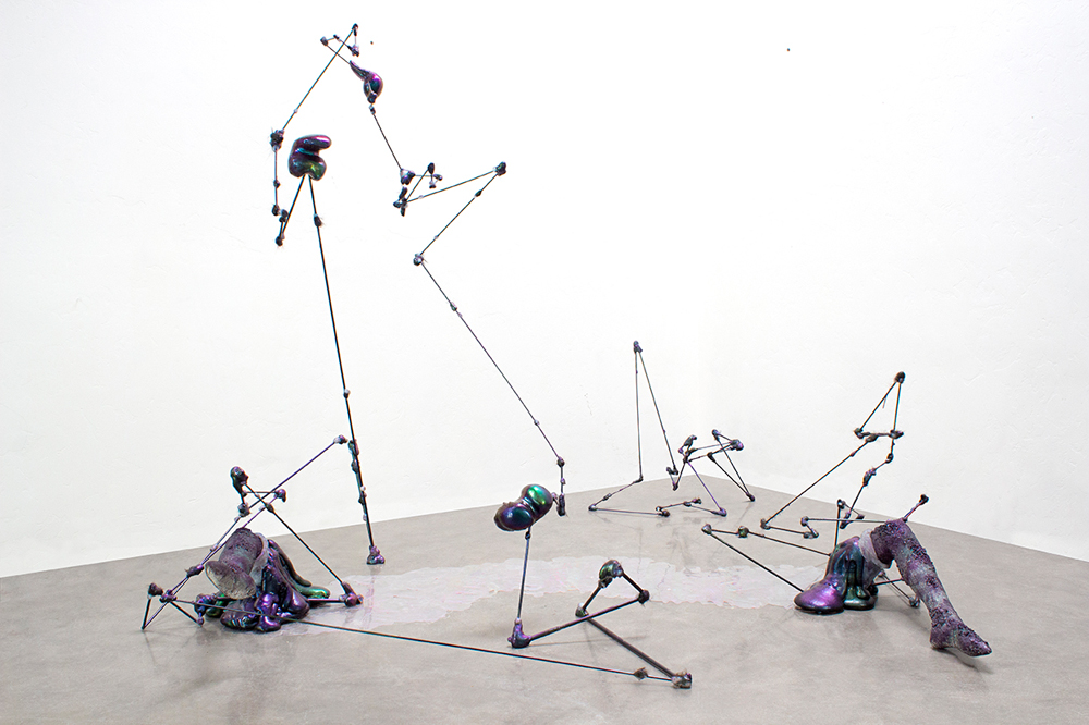 Galen Trezise  Catalytic Peacock Flow, 2018  Steel, Polystyrene, Expanding Foam, Epoxy Resin, Silicone,  Synthetic and Human Hair, Mica Pigment, Spray Paint  Variable Dimensions