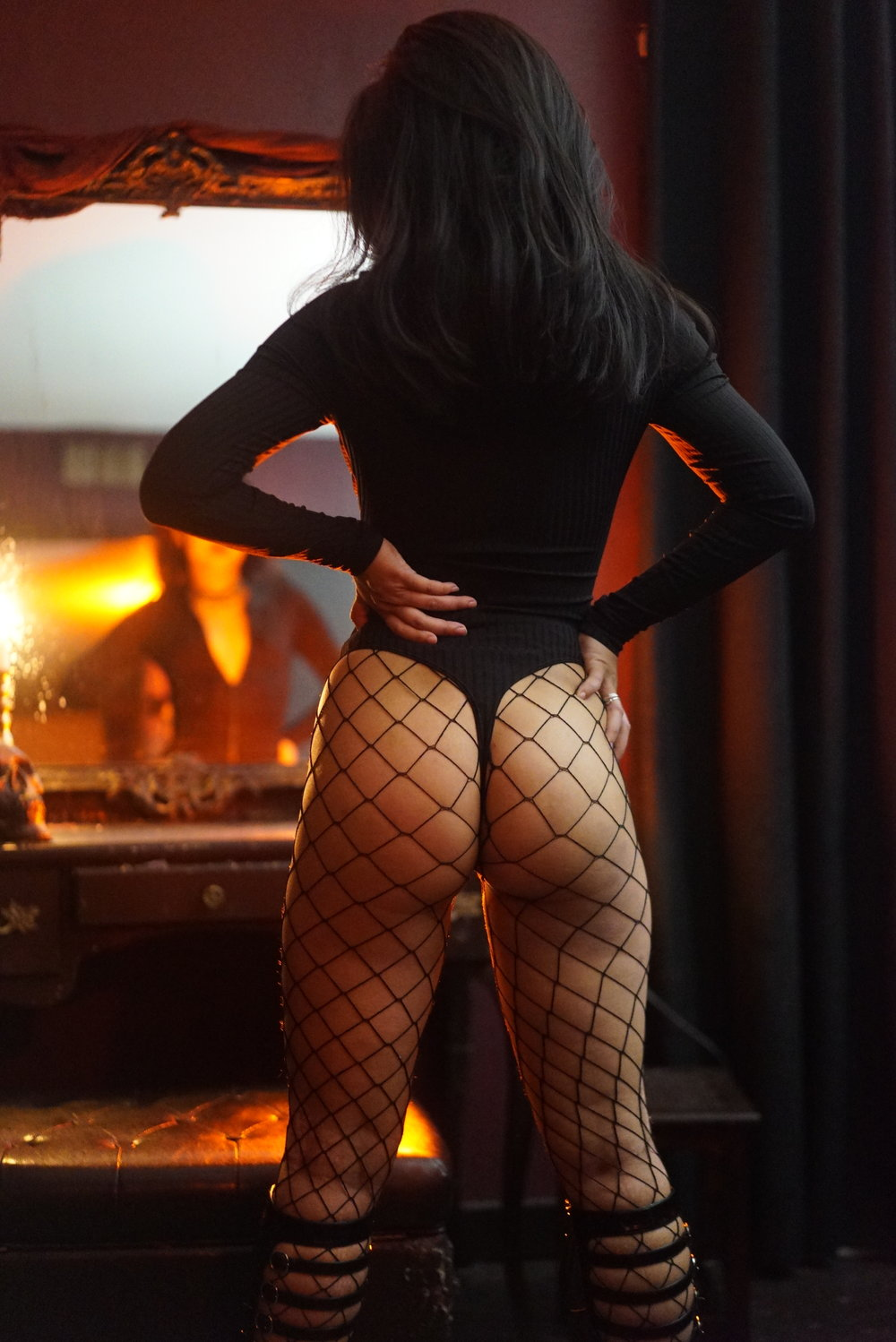 Get on your knees. Beg to stare up at New York dominatrix Empress Wu's beautiful ass in fishnets