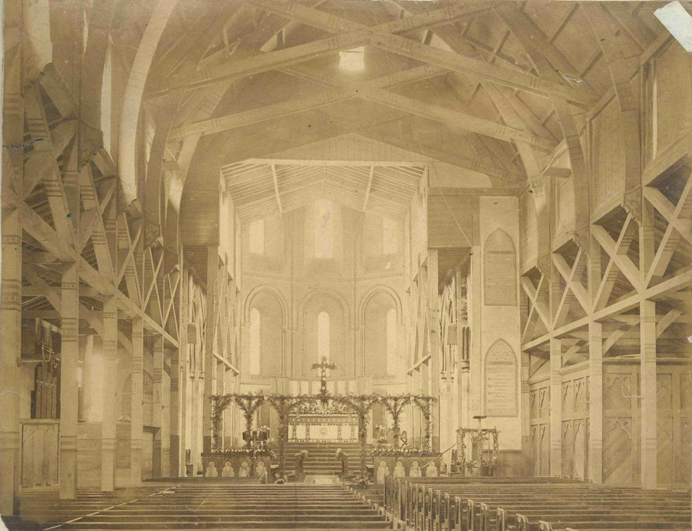 1870s: in the background, the present-day sanctuary has already been constructed in stone. The rest is still the original, temporary church - to be replaced in the following decades by the St John's we see today.