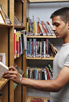 Teenager taking book.jpg
