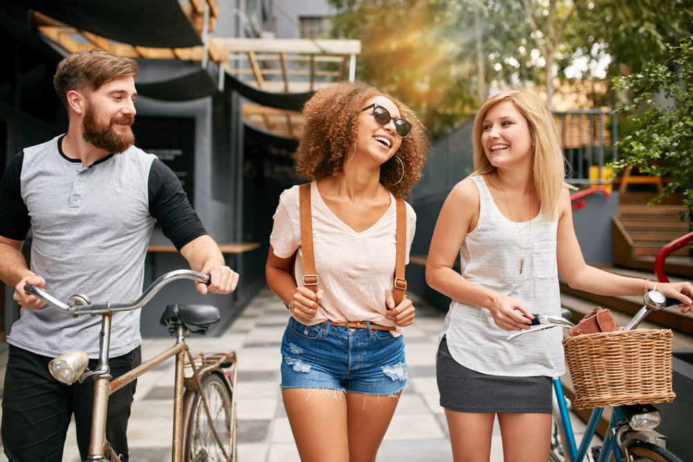 Happy-young-friends-walking-in-the-city-with-bikes-504861516_3869x2580 (1).jpeg