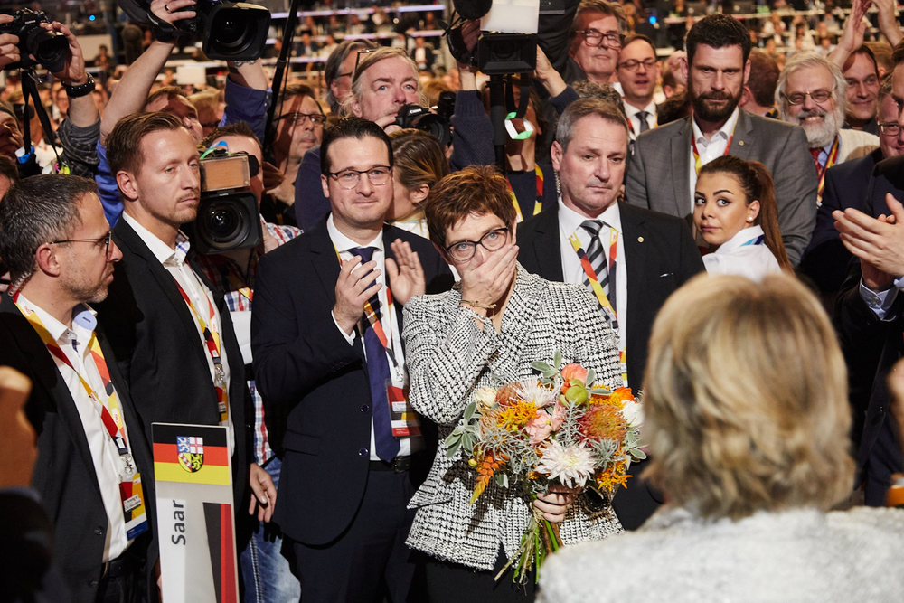 The Chosen One :  Annegret Kramp-Karrenbauer , who is commonly known as AKK or Mini-Merkel, served as minister president of Saarland, Germany's smallest state, before being hand picked by Merkel in February to serve as general secretary of the CDU. AKK struck an optimistic note in her speech at the party conference, asking the delegates to have the courage to stand against the zeitgeist and embrace her own positive vision for the future. She argued that this vision is the key to solving the problems facing Germany and Europe: digitalization, stagnant wages despite a strong economy, and inequality.
