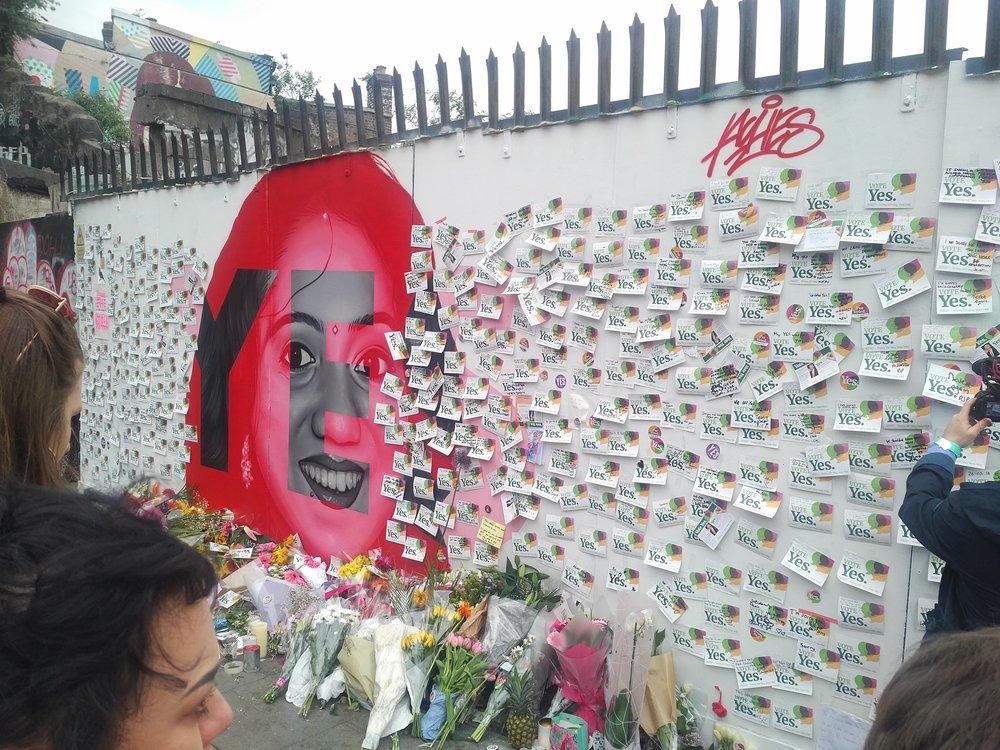 "Mural of Savita Halappananavar covered in ""Vote Yes"" stickers in Dublin, Ireland."