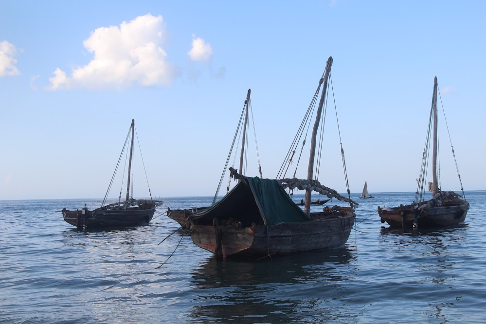 Fishing boats drift in the Indian Ocean