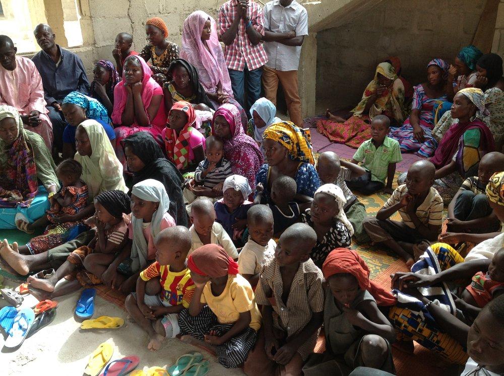 Victims of Boko Haram violence rest in a refugee camp. [ Flickr ]