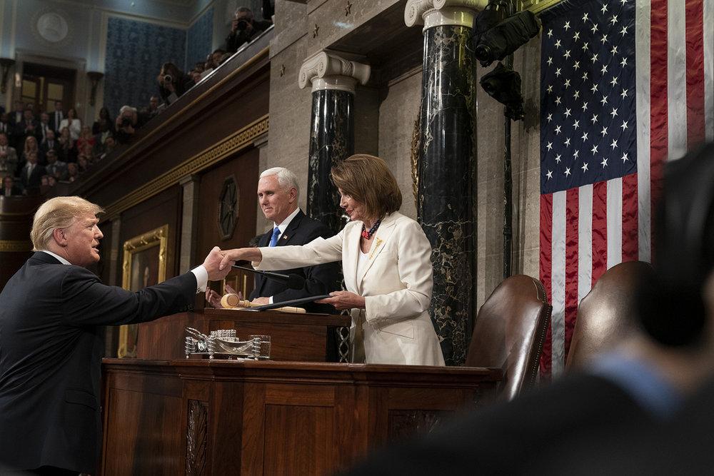 President Trump greets House Speaker Pelosi before beginning his speech. (Flickr)