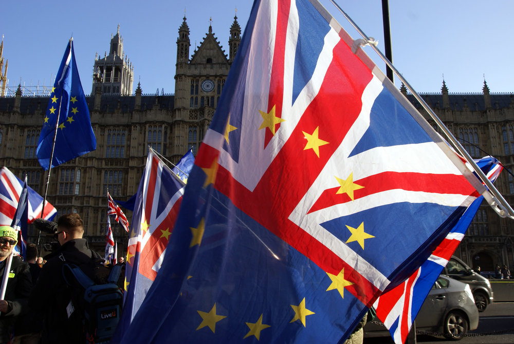 Protesters wave U.K.-EU flags in front of Parliament during Brexit deliberations. (Wikimedia Commons)