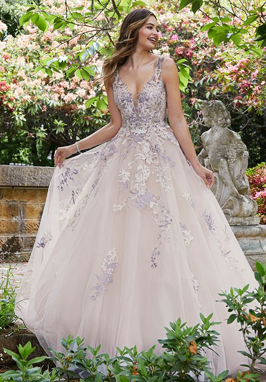 - Color – If you are loving the fact that gowns are coming in more colors like champagne and blush, there are more colors coming into bridal. We will be seeing colors like a pale blue and light lavender. This trend is perfect for trendy brides who want to stand out.