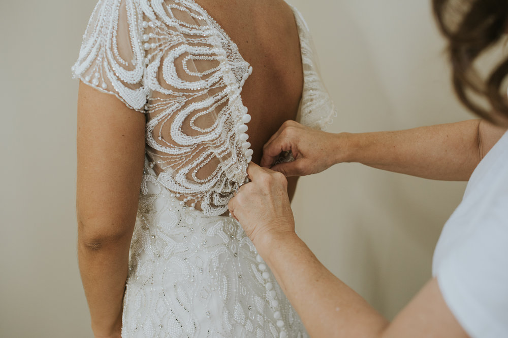 Beaded dress being buttoned