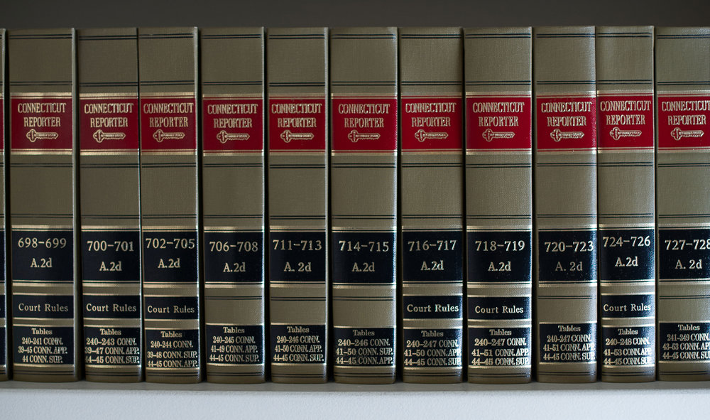 gold-law-books-lkm.jpg