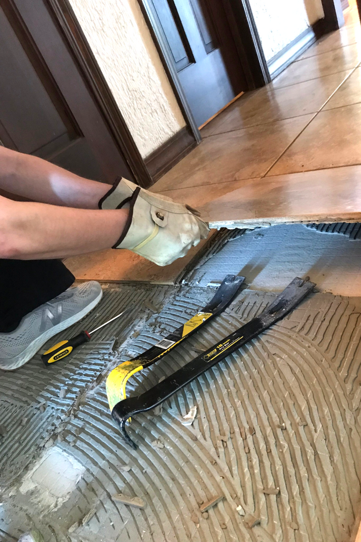 Removing Tile Using the prybar 2.png