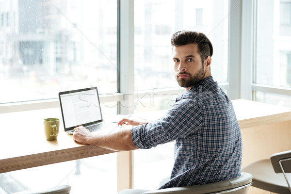 8395705_stock-photo-handsome-man-in-office-coworking-while-using-laptop-computer.jpg