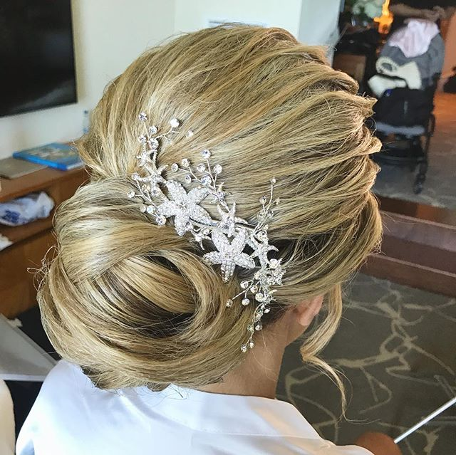 We're head over heels with this bridal updo for Michelle's wedding! #lucylubrides #bahamashairstylist  #destinationwedding #bahamasphotographer #bridalhairstyle #bridalupdo