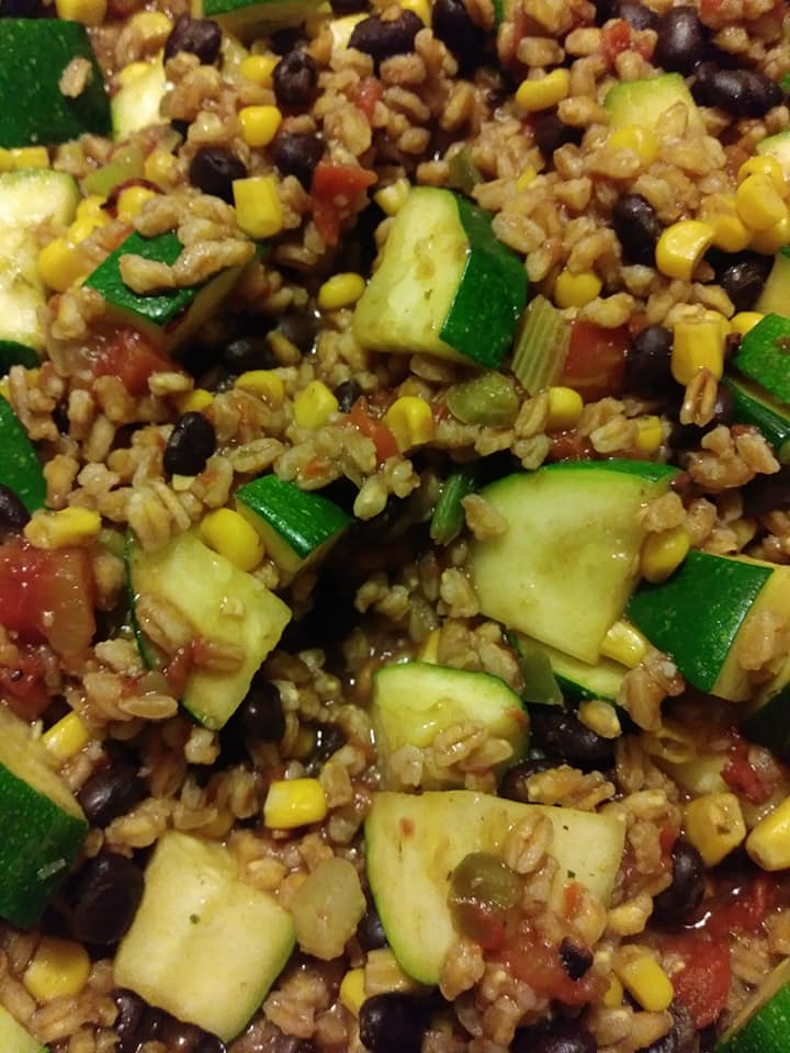 Zucchini with black beans, fire roasted tomatoes and pearled farro