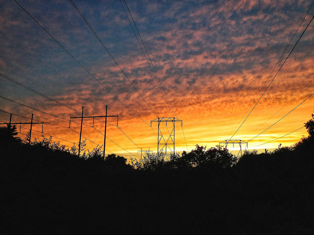 sunsettingonpowerlines.jpeg