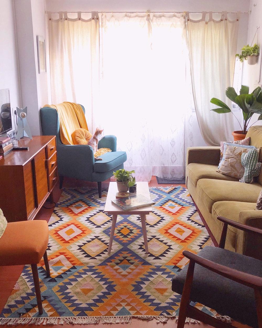 Orange chair: Pepperfry / Center table; Credenza, Grey chair:  Oshiwara  / Wingback chair: Urbanladder / Rug: Dilli Haat