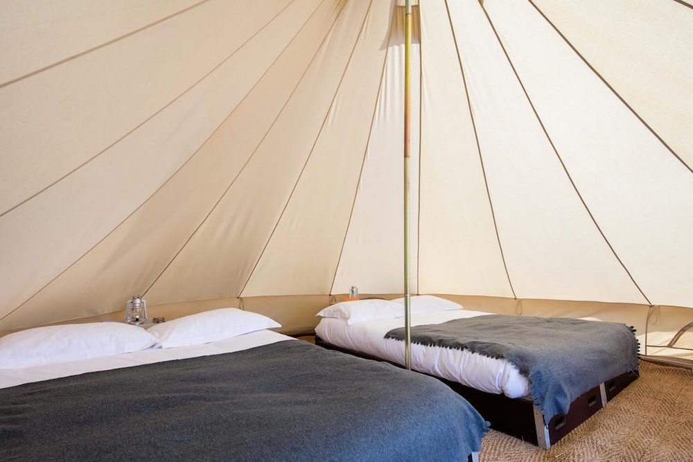 PX++ LUXURY WEEKEND GLAMPING - A step up from the basic bell tent, with hardwood beds and memory foam mattresses as standard, 200 thread count linen and hypoallergenic down duvets.From £480 // 2-4 pax.When booking your tent, please make sure you select the layout needed (double, family, couples, friends - see sketch layout below for available options)