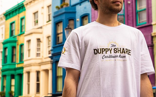 Duppy Merch featuring Notting Hill - the ultimate outdoor set for photoshoots since 1870. Available on our website - link in bio #RumLove . . . .  #nottinghill #london #photoshoot #beautiful #makemischief #theduppyshare #rumcocktails #portobello #fashion #londonfashion #streetwear #cocktails #westlondon #colourfulhouses #housegoals #tee #whitetee