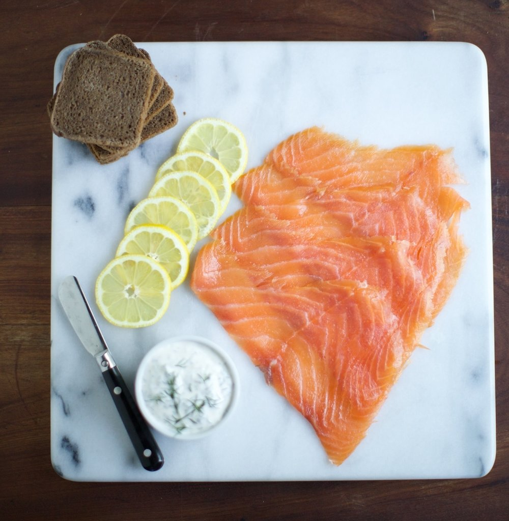 Smoked Salmon - Fresh salmon, salt, sugar and a smoldering fire is all we use to make all of our cold smoked salmon.