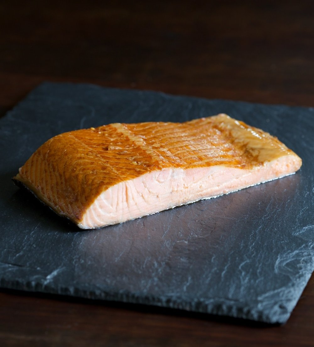 Kippered Salmon - Our kippered (baked salmon) is made from our fattiest, richest salmon. It's hot smoked to perfection. Perfect for a bagel or a salad.